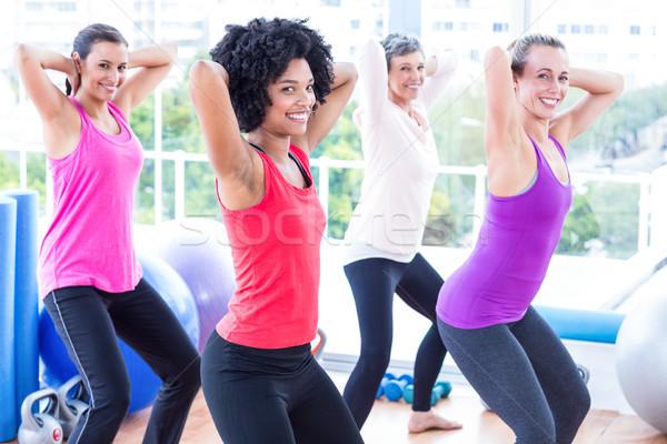 Portre gülen kadın egzersiz eller arkasında Stok fotoğraf © wavebreak_media