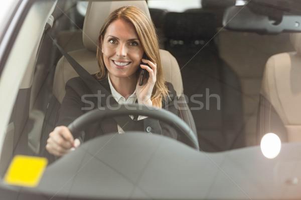 笑みを浮かべて 女性実業家 座って 車 新しい車 ストックフォト © wavebreak_media