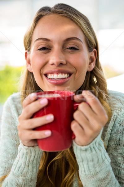 Young girl drink her coffee Stock photo © wavebreak_media
