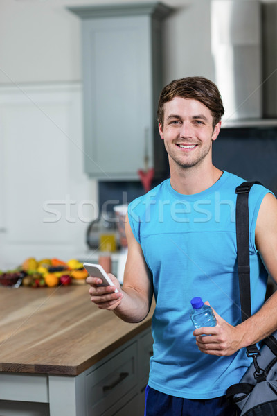 Healthy man sending text messages Stock photo © wavebreak_media