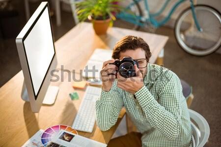 Kobiet wykonawczej aparat cyfrowy biuro Zdjęcia stock © wavebreak_media