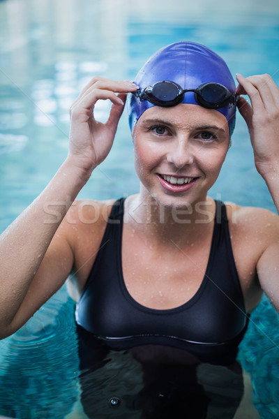 Fit woman wearing swim cap and goggles in the water Stock photo © wavebreak_media