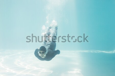 Fit woman swimming under water Stock photo © wavebreak_media