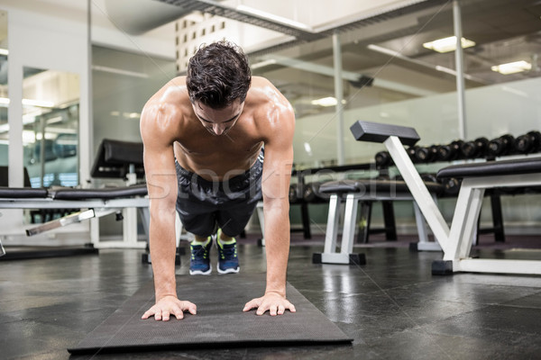 Shirtless man doing push up Stock photo © wavebreak_media