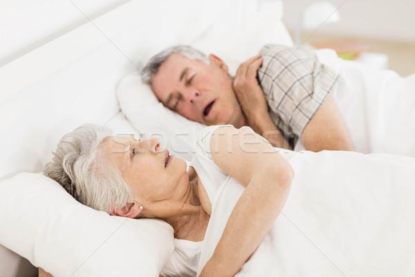 Awake senior woman in bed Stock photo © wavebreak_media