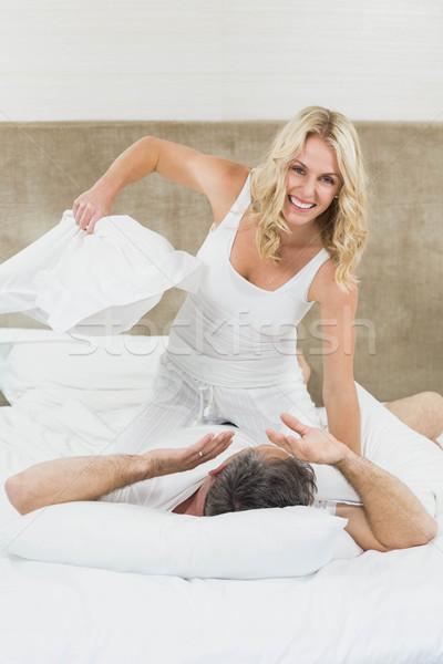Sevimli çift oynama yastık kavgası yatak kadın Stok fotoğraf © wavebreak_media