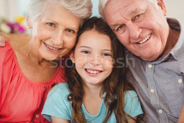 дедушка и бабушка внучка сидят вместе диван портрет Сток-фото © wavebreak_media