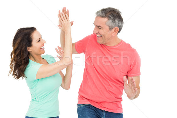 Excited couple giving a high-five Stock photo © wavebreak_media