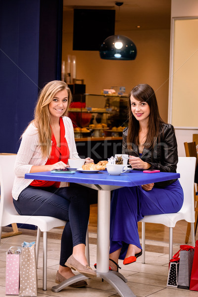 Women having coffee and snacks at a coffee shop Stock photo © wavebreak_media