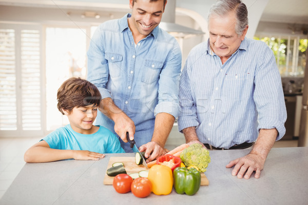 Man chopping vegetable with son and father Stock photo © wavebreak_media