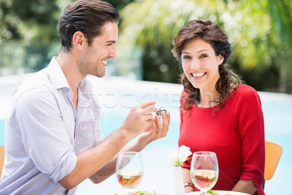 Portrait femme souriante bague de fiançailles mode couple boire Photo stock © wavebreak_media