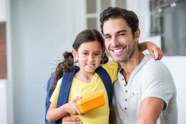 Portrait of smiling father and daughter with lunch box Stock photo © wavebreak_media