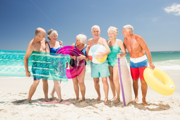 Senior friends with beach accessories Stock photo © wavebreak_media