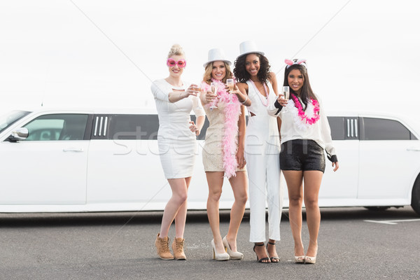 Frivolous women drinking champagne next to a limousine Stock photo © wavebreak_media