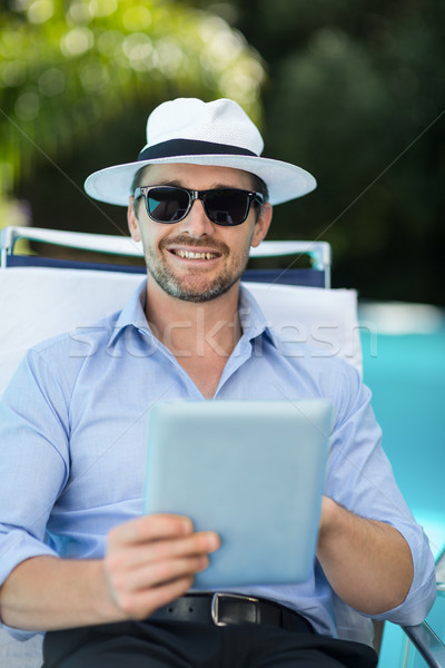 Smart man using digital tablet Stock photo © wavebreak_media