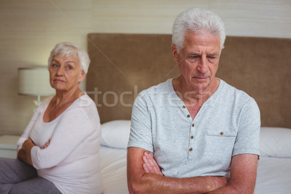 Unhappy senior couple after arguing while sitting on bed  Stock photo © wavebreak_media