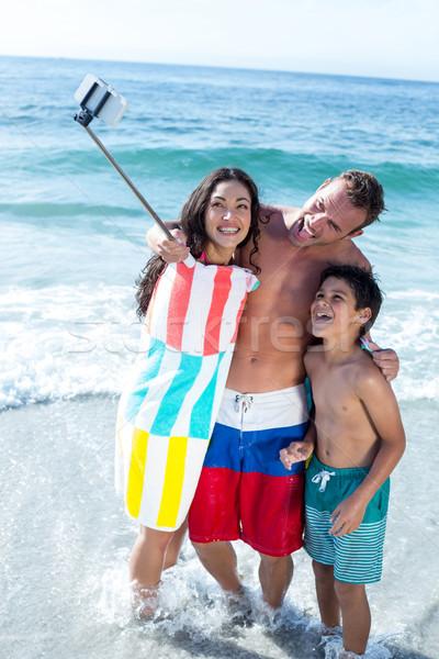 Wesoły rodziny stałego płytki wody Zdjęcia stock © wavebreak_media