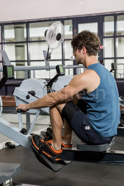 Stockfoto: Man · roeien · machine · gymnasium · gezondheid