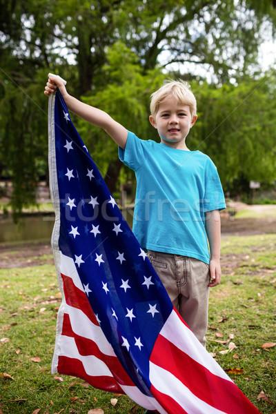 Fiú tart amerikai zászló park portré jókedv Stock fotó © wavebreak_media