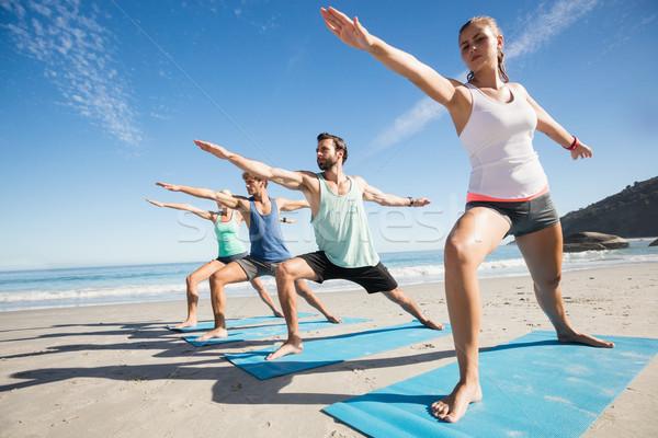 People doing yoga on the beach Stock photo © wavebreak_media