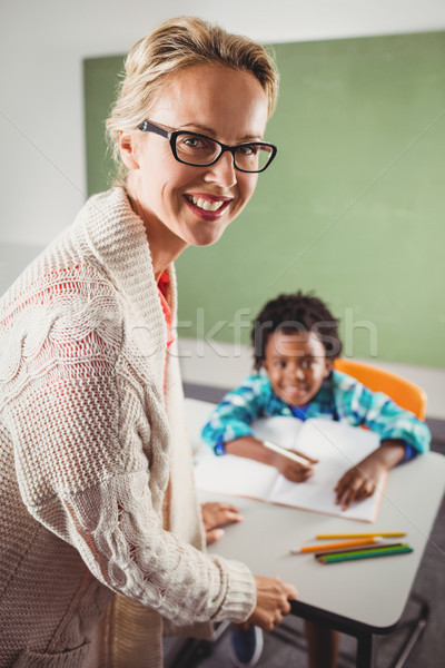 Teacher and pupil in the classroom Stock photo © wavebreak_media