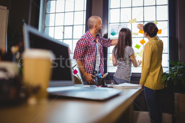 Business people discussing over sticky notes in office Stock photo © wavebreak_media