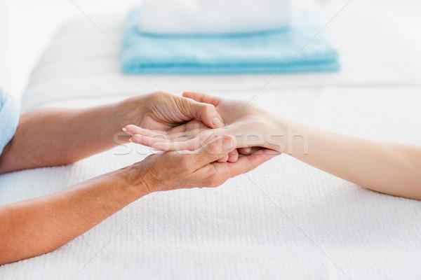Cropped image of woman receiving hand massage Stock photo © wavebreak_media