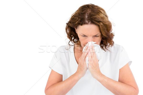 Irritated mature woman sneezing Stock photo © wavebreak_media