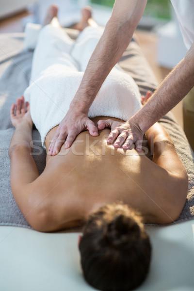 Male physiotherapist giving back massage to female patient Stock photo © wavebreak_media