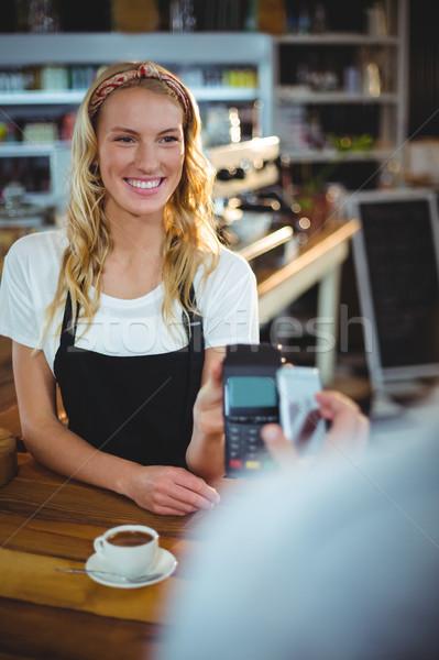 Customer paying bill through smartphone using NFC technology Stock photo © wavebreak_media