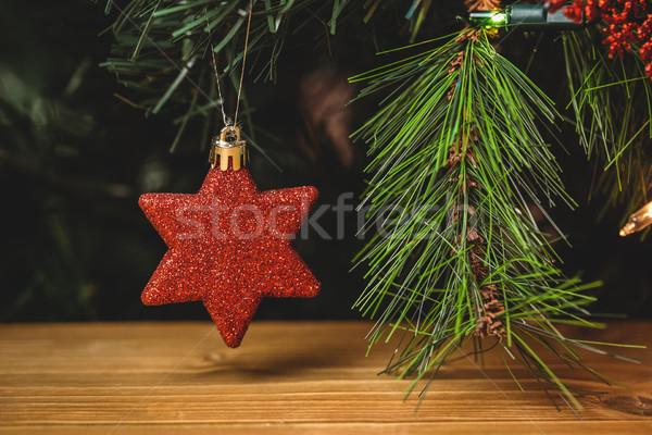 Close-up of christmas star hanging on christmas tree Stock photo © wavebreak_media