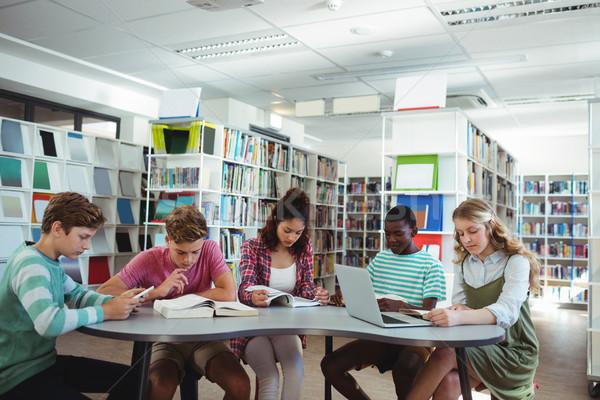 özenli sınıf arkadaşları eğitim kütüphane okul kitap Stok fotoğraf © wavebreak_media