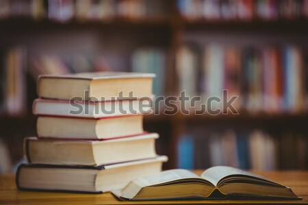 Close up of open book against close up of a bookshelf Stock photo © wavebreak_media