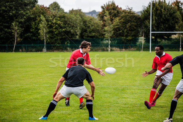 Rugby players passing during game Stock photo © wavebreak_media