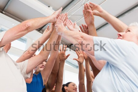 Stock photo: Woman joining hands for breast cancer awareness low angle view
