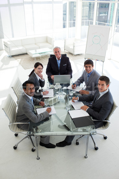 High angle of a business team smiling at the camera Stock photo © wavebreak_media