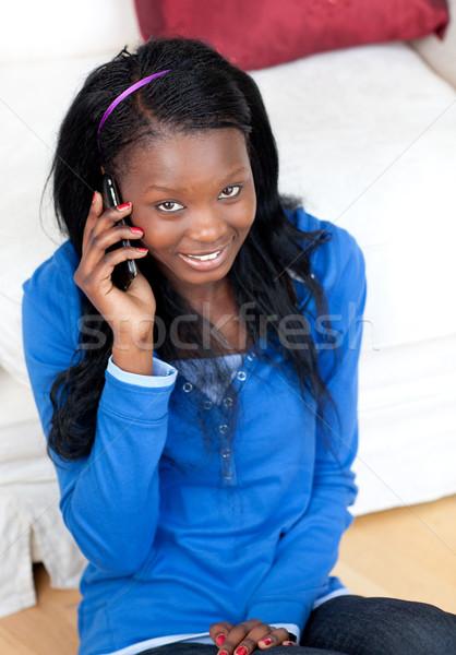 Gülümseyen kadın konuşma telefon livingroom oturma zemin Stok fotoğraf © wavebreak_media