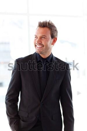 Karizmatikus üzletember összehajtva karok fehér üzlet Stock fotó © wavebreak_media