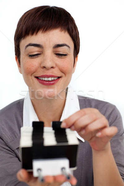 Confident businesswoman consulting a business card holder  Stock photo © wavebreak_media