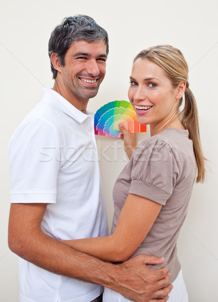 Lovers with color samples to paint their new house Stock photo © wavebreak_media