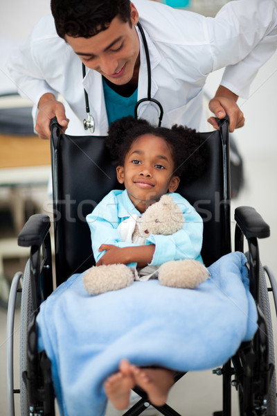 Young child being cared for by a doctor Stock photo © wavebreak_media
