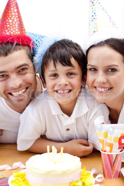 Smiling family celebrating son's birthday Stock photo © wavebreak_media