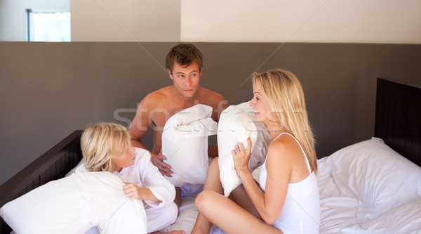 Parents and son having a pillow fight Stock photo © wavebreak_media