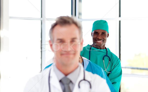 Smiling surgeon in a row Stock photo © wavebreak_media