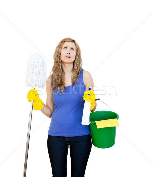 Unhappy woman with cleaning utensils against wihite background Stock photo © wavebreak_media