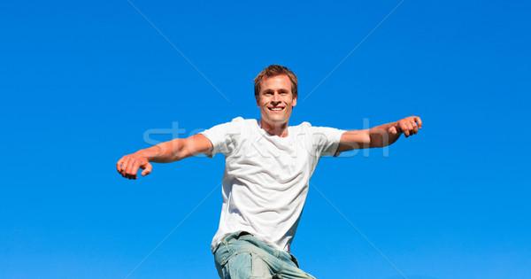 портрет кавказский человека прыжки воздуха Открытый Сток-фото © wavebreak_media