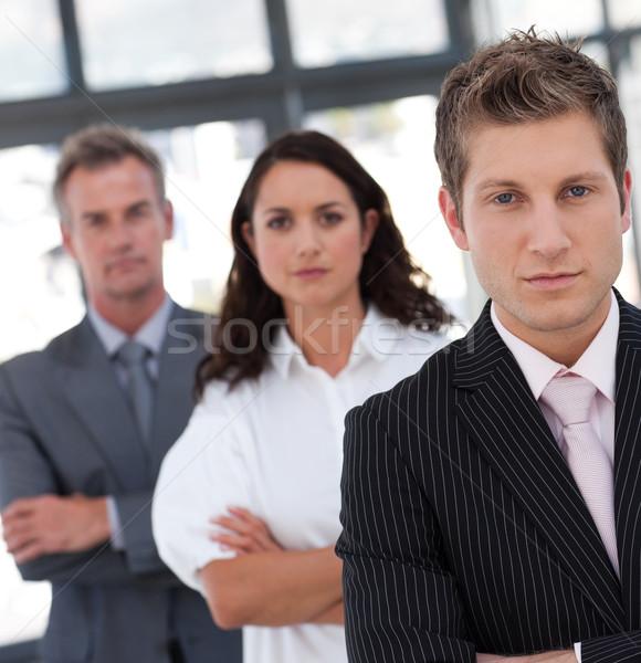 Portrait équipe commerciale regarder caméra bureau Photo stock © wavebreak_media