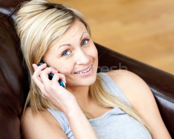Lively woman using a phone in the living-room  Stock photo © wavebreak_media