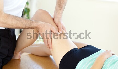 Young physical therapist giving a leg massage Stock photo © wavebreak_media