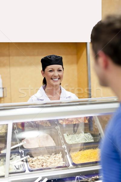 Alegre padeiro atrás exibir cliente fila Foto stock © wavebreak_media